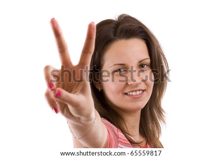 Young excited woman making victory sign isolate on white background - stock photo