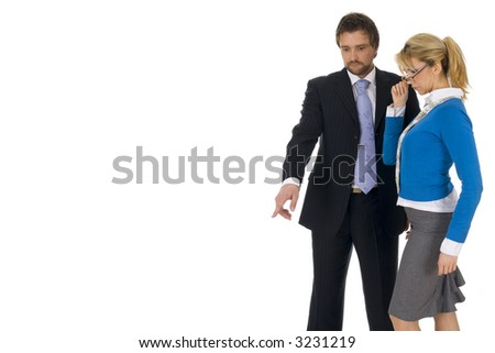 Young executive man with attractive blond pointing down to... isolated on white background - stock photo