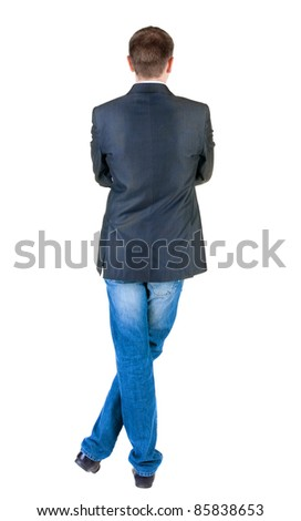 young expert looks ahead. rear view. Isolated over white . - stock photo