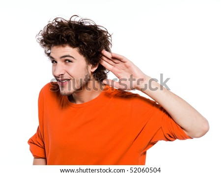 young expressive caucasian man portrait in studio on white background with his hand in the back of the ear - stock photo