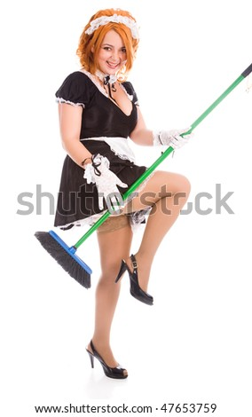 young expressive housemaid with apron and broom - stock photo