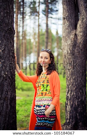 Young fairy woman in the forest between two trees - stock photo