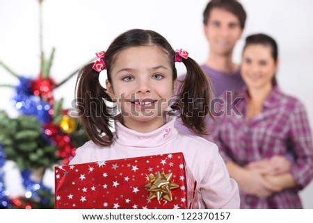 Young family at Christmas - stock photo