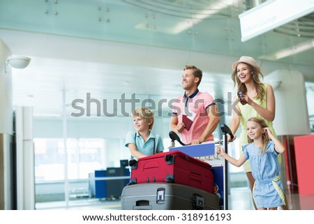 Young family at the airport - stock photo