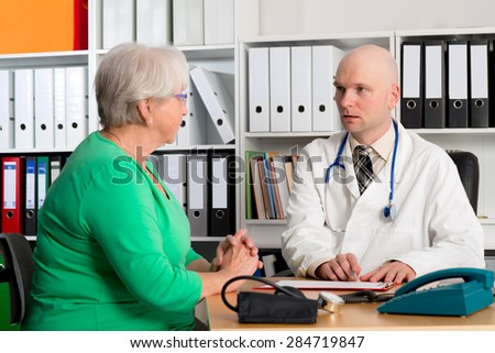 young family doctor examine a female senior - stock photo