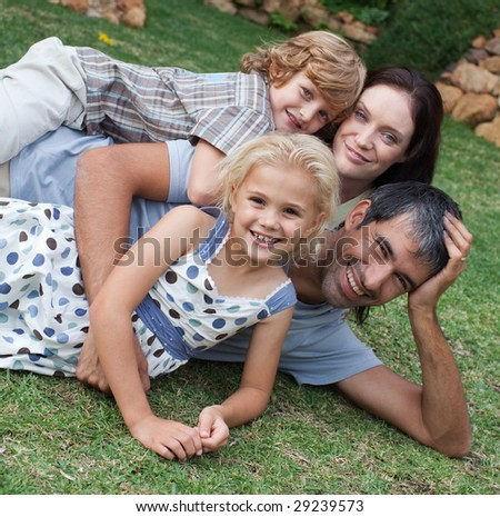 Young Family enjoying the summer in the garden - stock photo