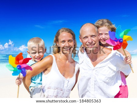 Young family enjoying their summer vacation. - stock photo