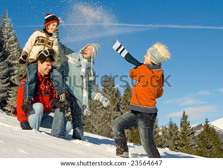 young family having fun in winter landscape - stock photo