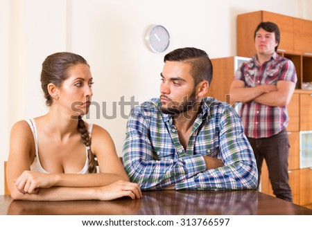 Young family having having argue about troubles at home - stock photo