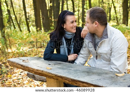 Young family in love in the forest - stock photo
