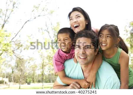 Young Family In Park - stock photo