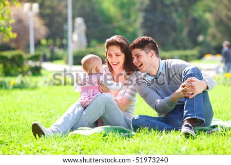 Young Family in the park enjoying spring - stock photo