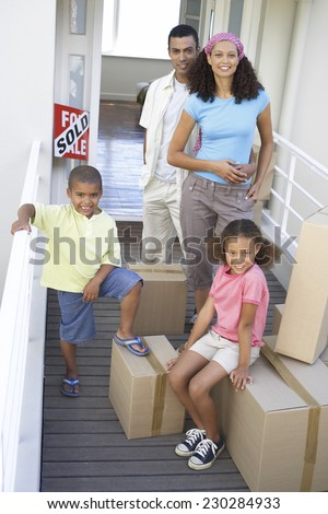 Young Family Moving House - stock photo