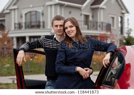 young family near car on background house, outdoors - stock photo