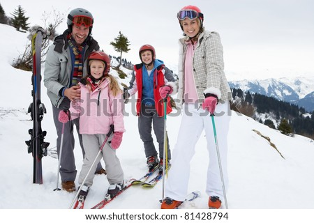 Young Family On Ski Vacation - stock photo
