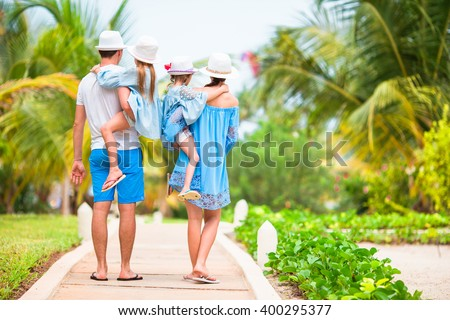 Young family on vacation - stock photo