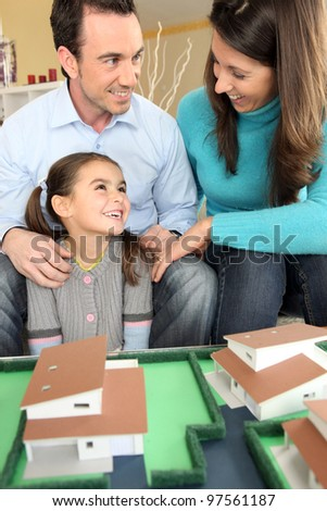 Young family planning their new house - stock photo