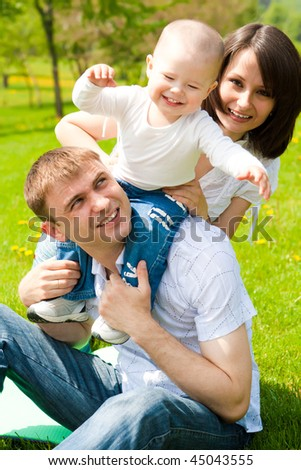 Young family playing in a spring park - stock photo