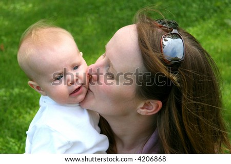 Young family together in trees on spring day - stock photo