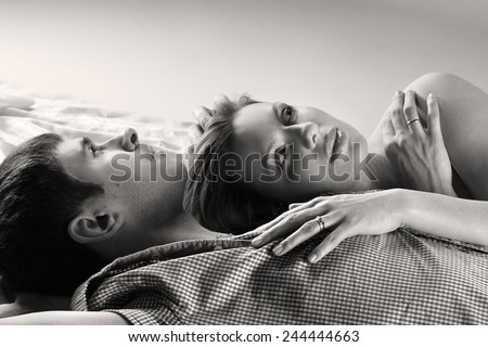 young family waiting for baby to bed. the tender feelings of lovers. love for the baby. family values - stock photo