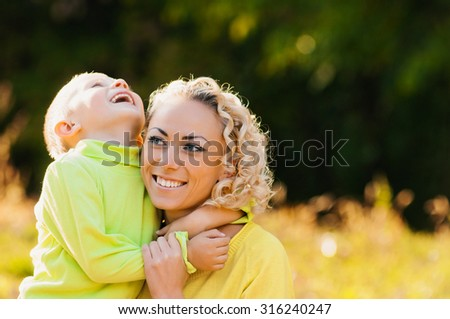 Young family walking in the park. Autumn. Smiling - stock photo