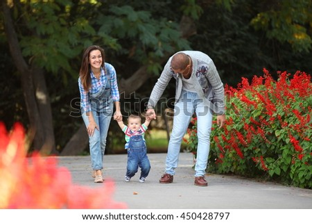 young family walking, teaching to baby - stock photo