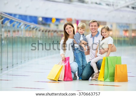 Young family with children in the store - stock photo