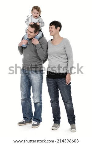 Young family with kid on piggyback - stock photo