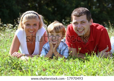 Young family with one child - stock photo