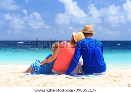 young family with small child on the beach - stock photo
