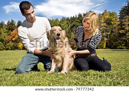 Young Family with their dog - stock photo