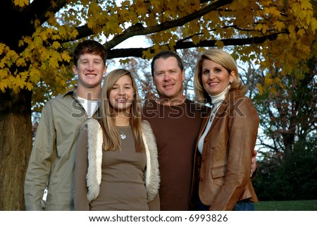 young family with two teen children - stock photo