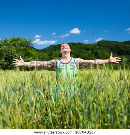 Young farmer outdoor in the wheat field - stock photo