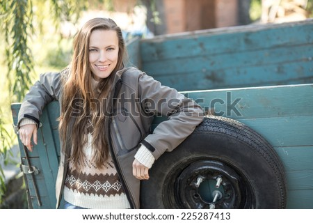 Young farmer with agricultural trailer  - stock photo