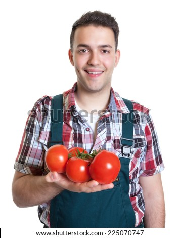 Young farmer with fresh tomatoes - stock photo
