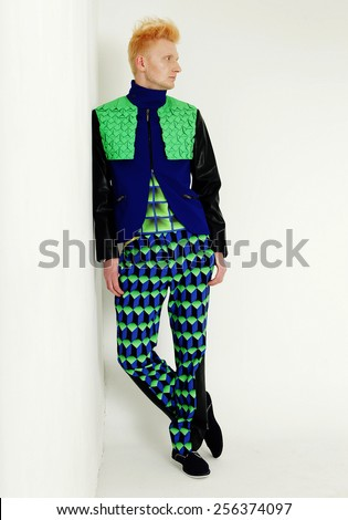 young fashion man full body a in the studio - stock photo