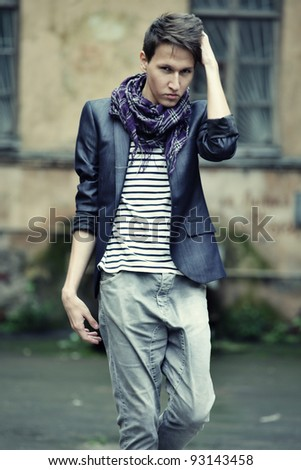 young fashion man in casual wear. posing on the street. - stock photo
