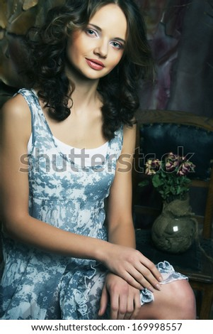 young fashion model in art decoration - stock photo