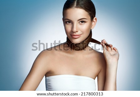 Young fashion model / photoset of a gorgeous brunette smiling girl on studio background  - stock photo