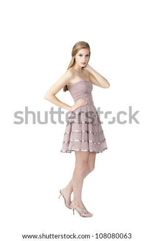 young fashion model posing at white background with blond hair and blue eyes - stock photo