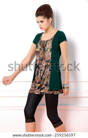 young fashion model posing in studio - stock photo