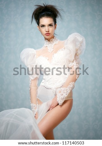 Young fashion model wearing lace body suit - stock photo
