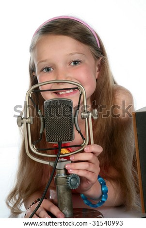 young fashion-monger with a microphone starm - stock photo