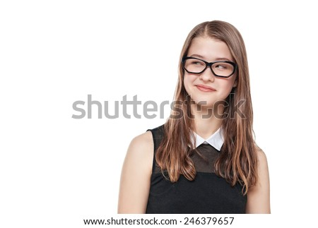 Young fashion teenage girl in glasses looking on something isolated  - stock photo