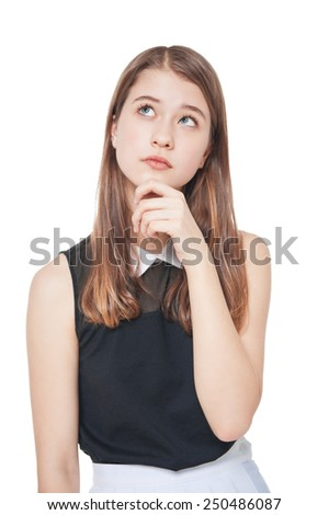 Young fashion teenage girl in glasses looking up on something - stock photo
