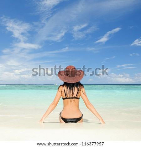 Young fashion woman on the beach - stock photo