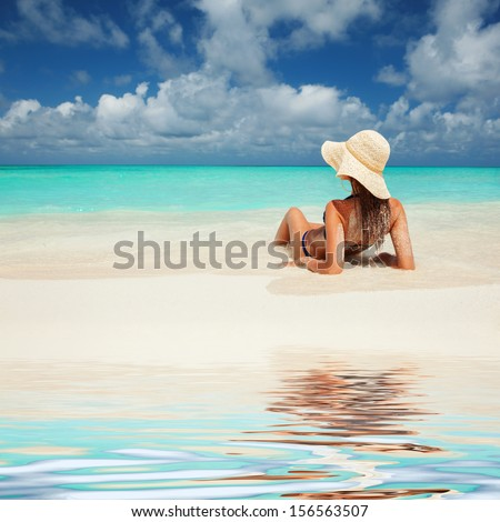Young fashion woman relax on the beach - stock photo