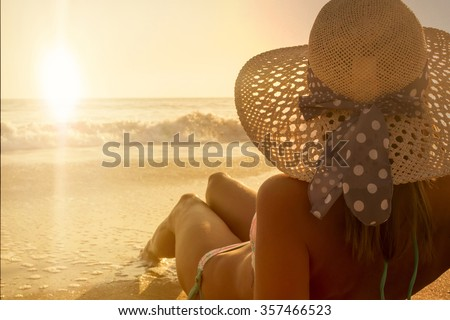 Young fashion woman sunbathing relax on the beach - stock photo