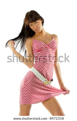 Young fashionable girl in red and white striped dress. Isolated over white - stock photo
