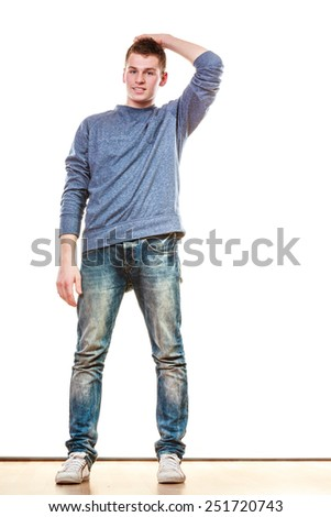 Young fashionable man in full length casual style blue jeans posing isolated on white - stock photo